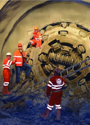 The crew celebrates the breakthrough of the Robbins TBM at the Milchbuck Safety Tunnel, December 2012.