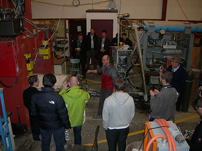 Laboratory manager Brian Asbury (center) gives a tour of the Earth Mechanics Institute.